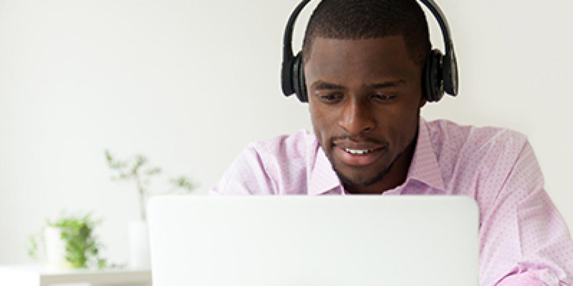 man on desktop computer