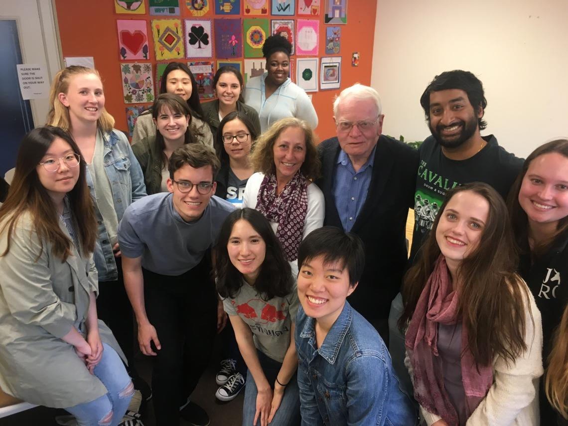 Neal Ball, Founder and Honorary President of the American Refugee Committee, and students