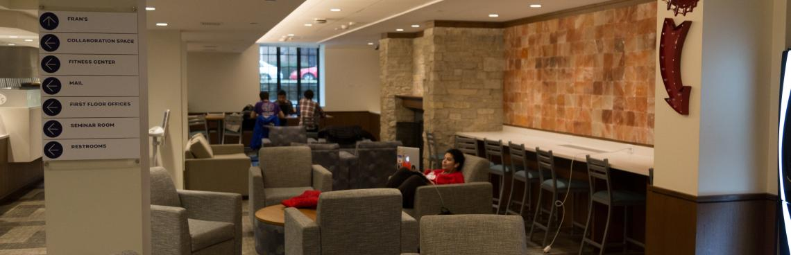 Students work collaboratively outside the classroom in the Engagement Center lounge