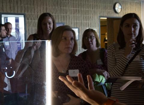 Faculty watching a tech demo