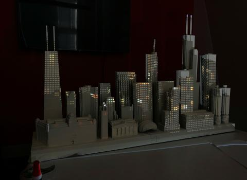 a die-cut model of the Chicago skyline